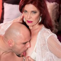 Mature woman with red hair Dana Devereaux face sits her toy boy after giving a blowjob