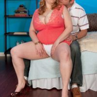 Redhead BBW Sadie Berry seduces a man by flashing upskirt cotton panties