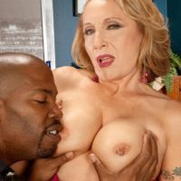 Sexy mature woman Luna Azul seduces a younger black man in satin lingerie and jeans