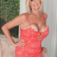 60 plus MILF Leah L'Amour seduces a younger man at the door with her big tits out