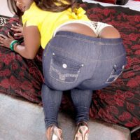 Black MILF Stacy Love sports a whale tail while freeing her big booty from jeans in heels