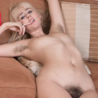 Blonde solo girl Aali Rousseau stretches her hairy pussy during a close up in bare feet