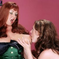 Busty mature lesbians Angela White and Cherry Brady play lezdom games in lingerie