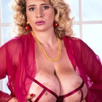 Famous pornstar Crystal Topps unleashes her massive boobs in nylons and garters