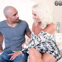 Hot 60 plus MILF Madison Milstar seduces a younger black man in a tight fitting dress