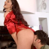 Hot brunette MILF Caroline Pierce has her big butt and pussy licked in a satin corset