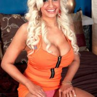 Platinum blonde MILF Holly Brooks seduces a man with her huge breasts in a miniskirt