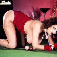 Pornstar Nilli Willis exposes her massive tits on pool table in red gloves and dress