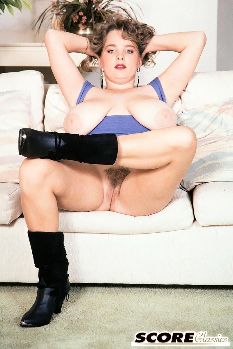 Solo girl Rhonda Baxter sets her massive boobs and trimmed bush free of dress in boots