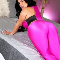 Thick Latina female Destiny uncovers her big tits in a skintight bodystocking and heels