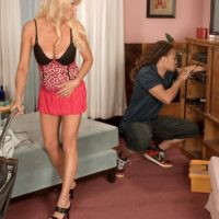 Hot blonde granny with great legs Natasha seduces a blows a younger black man