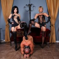 Hot females Belle Noir and Brianna put a naked male sub thru his paces in revealing clothes