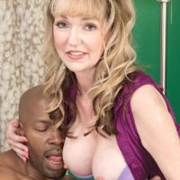 Hot granny Janee Diamond seduces a younger black man before sucking his BBC