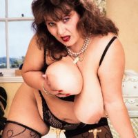 Mature BBW Ildiko plays with her huge tits in sexy stockings during solo action