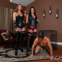 Michelle Lacy and a hot girlfriend dominate a hooded male in latex and long boots