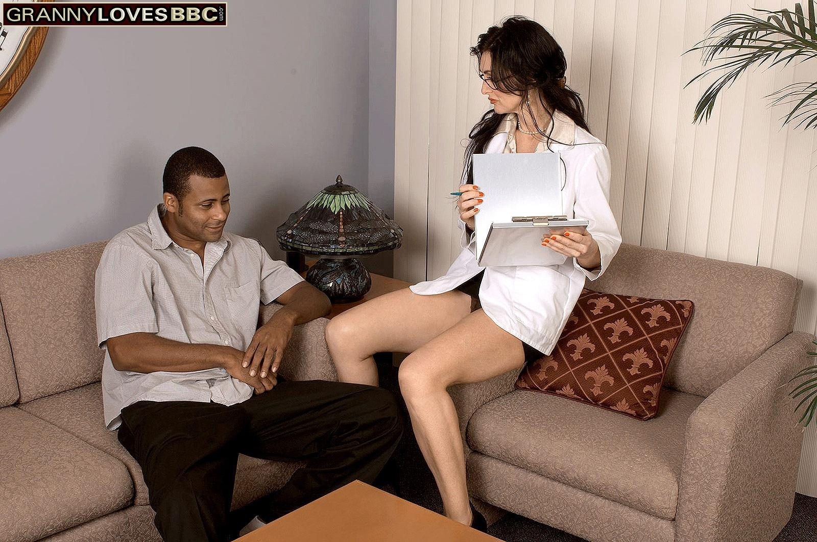 Sexy brunette granny Lake Russell seduces a blows a younger black man on a sofa