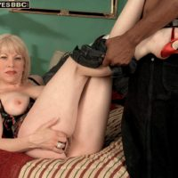 Blonde granny Jennifer Janes has her boobs groped while being disrobed by a black man