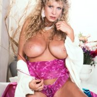 Blonde MILF with great legs Lynden Johnson sets forth her huge tits in solo action