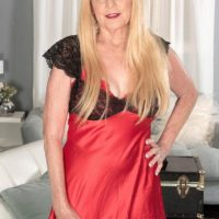 Blonde Nan Charlie seduces a younger man in lingerie and black stockings