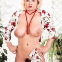 Blonde solo girl Louise Leeds flaunts her giant tits and bush in white stockings