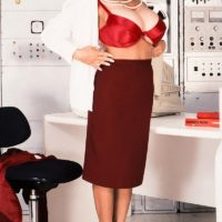 Brunette businesswoman Busty BriAnna shows her great legs and giant tits at once
