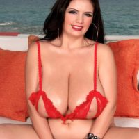 Brunette MILF Arianna Sinn sets her massive tits free of her revealing brassiere