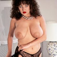 Brunette MILF Stacey Owen puts her huge tits on display in garters and nylons