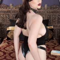Brunette solo girl Tiggle Bitties fondles her huge tits wearing black lingerie
