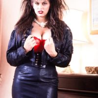 Brunette solo model Jeannine Oldfield unleashes her huge boobs in leather and hose