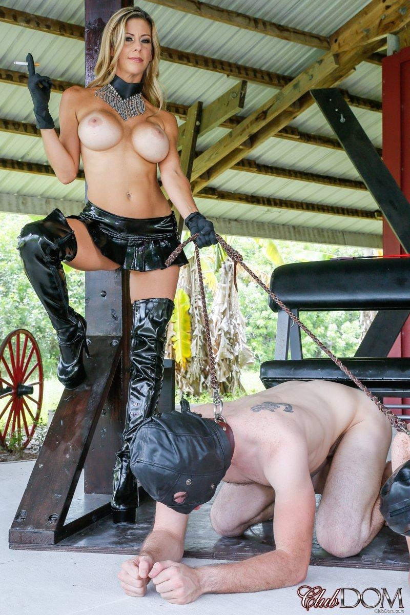 Busty blonde Alexis Fawx keeps a couple of males slaves in hoods on leashes
