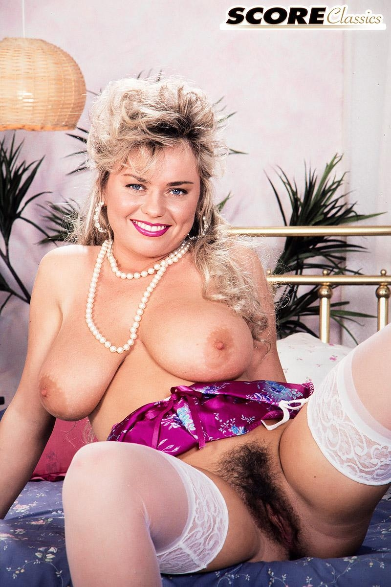 Dirty blonde MILF Michelle Willings bares her huge boobs and bush in solo action