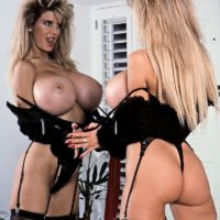 Famous pornstar Busty Dusty presses her giant tits up against a mirror