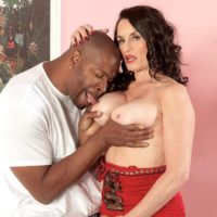 Hot brunette granny Rita Daniels seduces a younger black man with her great legs