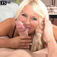 Hot older woman Annellise Croft has her big tits sucked on before a titty fuck