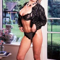 Mature MILF Debbie Q proudly displays her great tits in black underwear