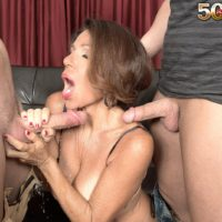 Mature woman Layla LaMora tangles with a couple of large cocks at the same time