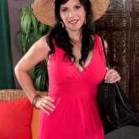 Older brunette lady Raven Flight is stripped naked by her younger Latino lover