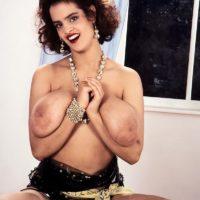 Redhead model Nilli Willis puts her giant tits on display in sexy nylon socks