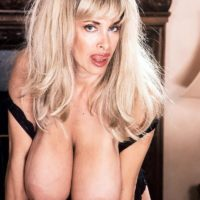 Sexy blonde Alexis Love releases her massive tits from black lingerie