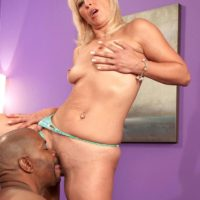Sexy granny Andi Roxxx has her pussy licked out by her young black lover