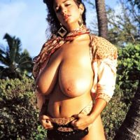 Sexy MILF Devon Daniels displays her massive boobs while at the beach in boots