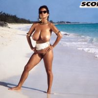 Sexy MILF Devon Daniels unleashes her giant boobs while hanging at the beach