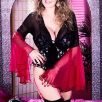 Solo girl Lisa Kelly cradles a large breast in nylons paired with garters