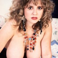 Solo girl with curly hair Tracy West sets her beautiful tits free of sexy lingerie