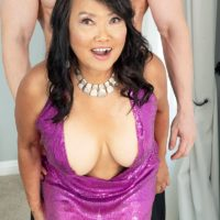 60 Plus Asian MILF Mandy Thai wears no bra under her dress while seducing a boy