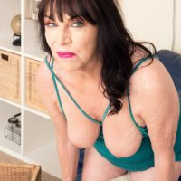 60 plus MILF Christina Starr uncovers her sagging boobs as she gets totally naked