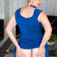 Blonde granny with short hair Seka Black strips to tan nylons wearing a choker