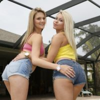 Clothed chicks Marsha May and Hope Harper model in jean shorts by a pool