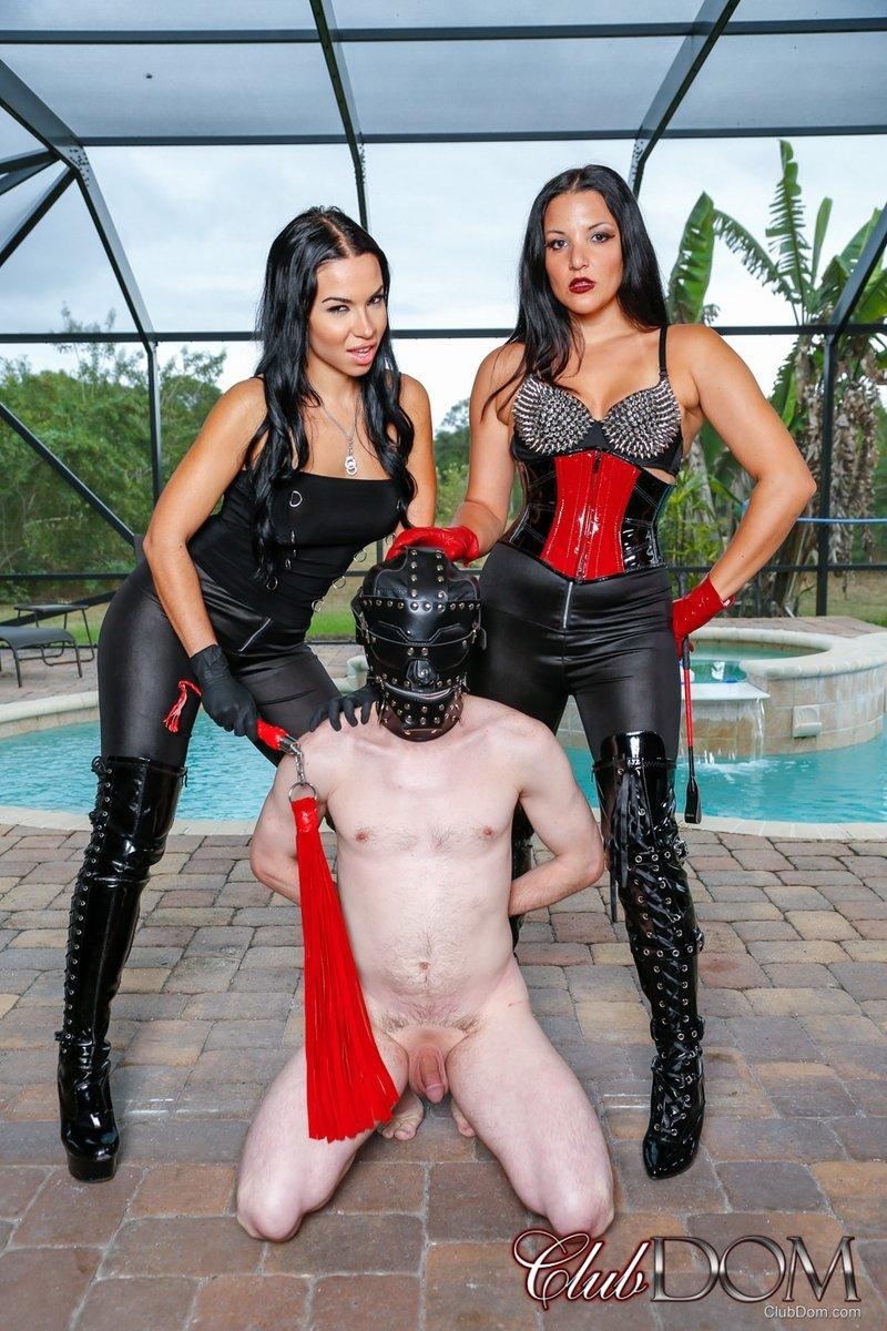 Dark haired females Kylie Rogue and Michelle Lacy dominate a hooded male sub