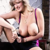 Famous pornstar Debbie Q sets her great tits free of a tight dress in solo action